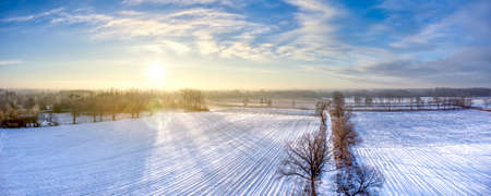 Field covered with snow in a cold winter morning Lizenzfreie Bilder
