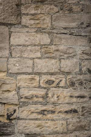 Eine Textur der alten unregelmäßigen Stein Ziegel
