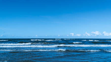 Sea waves with clear blue sky