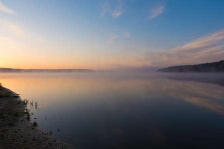 Magical sunrise with light fog over a lake (Zalew Chancza, Poland)