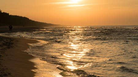Sea waves lit beautifuly by a worm light of setting sun