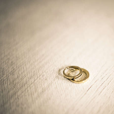 A pair of golden wedding rings, macro shot with very shallow depth of field
