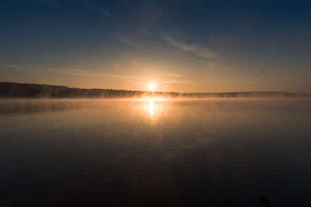 Magical sunrise with light fog over a lake (Zalew Chancza, Poland)