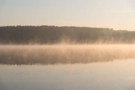 Magical sunrise with light fog over a lake (Zalew Chancza, Poland) Reklamní fotografie - 84006909