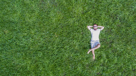 Man lying on a grass