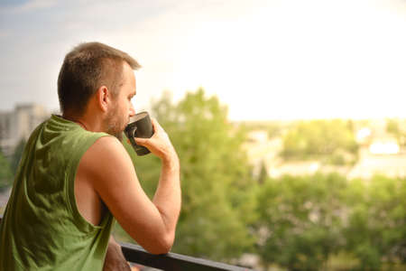 Man having coffee on a balcony
