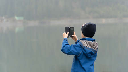 Boy taking photo with smartphone