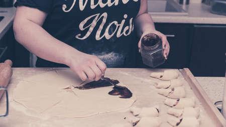 Preparing crescent rolls Standard-Bild