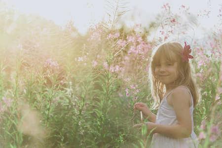 Little angel in flowers Standard-Bild