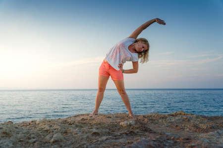 Žena, která dělá ranní cvičení