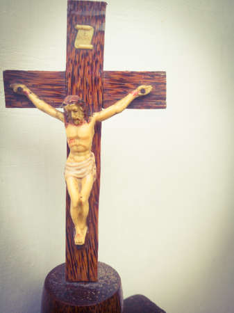 Holy cross with crucified jesus hanging on it is taken from front side.The cross is placed on the focus point.