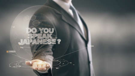 el mundo en tus manos: Do Your Speak Japanese Businessman Holding in Hand New technologies