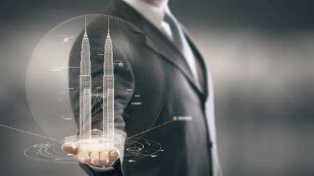 Petronas Towers Zakenman die in Hand Landmark houdt Nieuwe technologieën