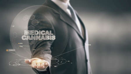 legalization: Medical Cannabis with hologram businessman concept Stock Photo
