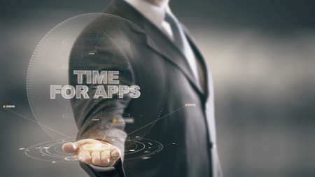 Time For Apps with hologram businessman concept