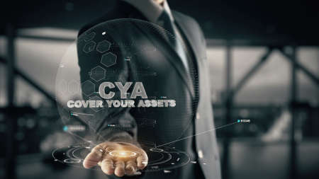 CYA-Cover Your Assets with hologram businessman concept Stock Photo