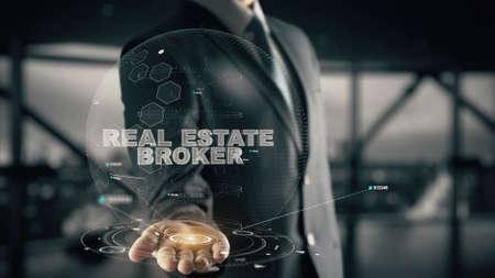 Real Estate Broker with hologram businessman concept Imagens