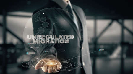 emigranti: Unregulated Migration with hologram businessman concept Archivio Fotografico