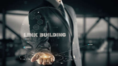 Link Building with hologram businessman concept Stock Photo