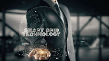 Smart Grid Technology with hologram businessman concept