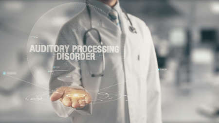 Doctor holding in hand Auditory Processing Disorder Stockfoto