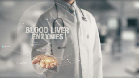 Doctor holding in hand Blood Liver Enzymes Foto de archivo