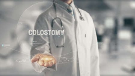 colostomy: Doctor holding in hand Colostomy