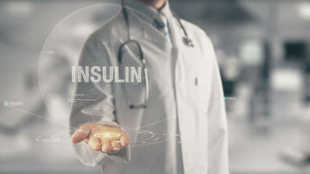 Doctor holding in hand Insulin Stock Photo