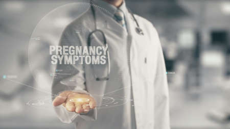 Doctor holding in hand Pregnancy Symptoms