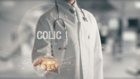 Doctor holding in hand Colic