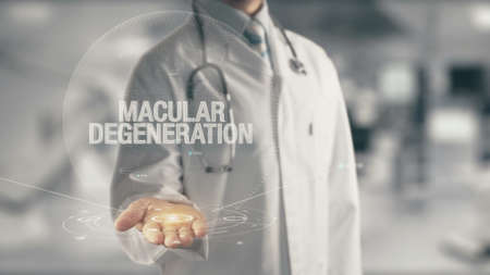 Doctor holding in hand Macular Degeneration