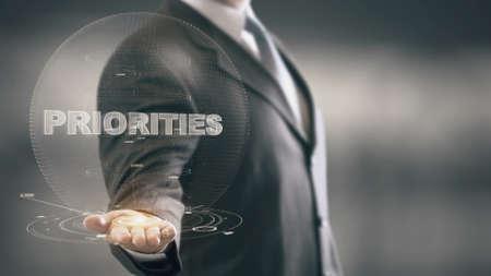 Priorities Businessman Holding in Hand New technologies Archivio Fotografico
