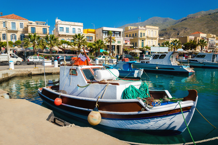 fishing nets: Colorful wooden boat in cosy Greek port in summer time