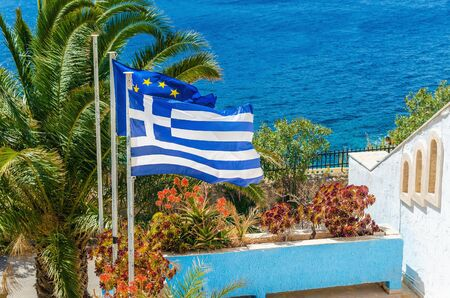 greek island: Greece and European Union flag on the background of plam tree and sea taken on Greek Island, Greece