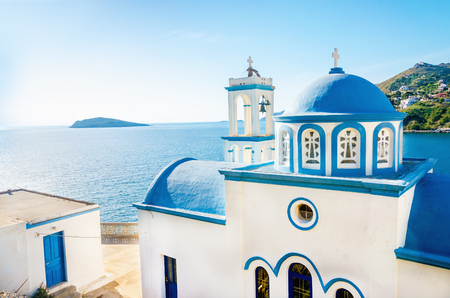 church dome: Typical Greek blue dome of white church with sea view in sunny day , Greece