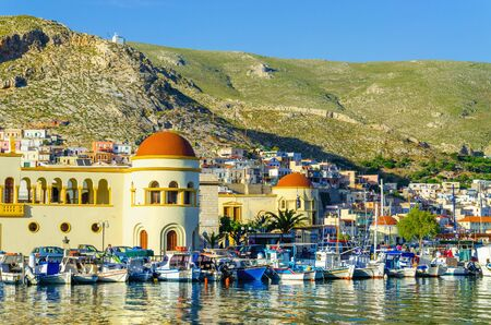 greece shoreline: Pothia, capital and the port of Kalymnos,  harbor view with colorful boats, Greece Stock Photo