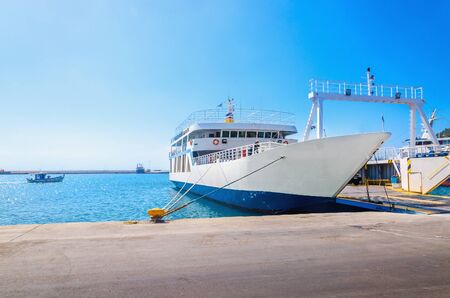ferries: View of empty ferry in typical Greek blue white colors waiting in harbour to be loaded with cars