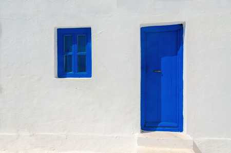 greek islands: Iconic blue wooden door and window against clear white wall. Typical view for Greek islands, Greece