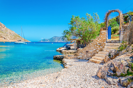 greece: Stairs from sandy beach of amazing bay on Greece island Kalymnos, Greece Stock Photo