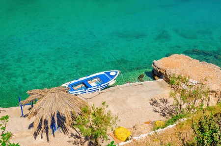 aeolian: Small motorbat docked in peaceful bay, Greece