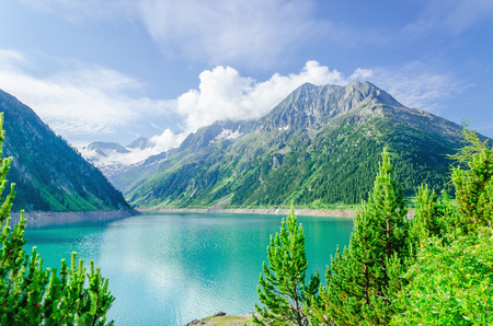 mountain valley: Azure mountain lake on the background of the high peaks of the Alps, Zillertal, Austria