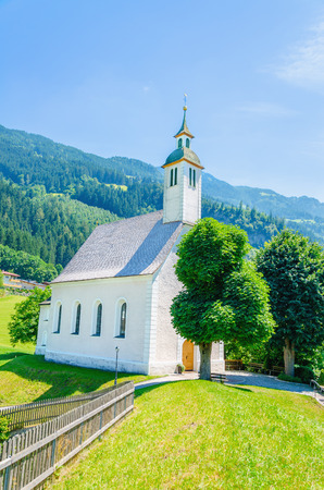 Beautiful alpine landscape with typical white high alpine church, Austrian Alps, Europe