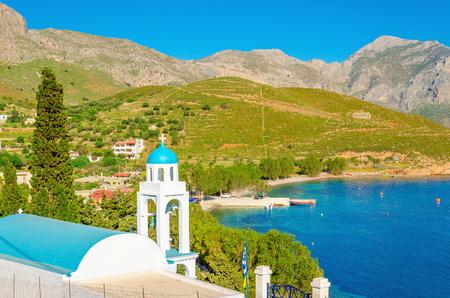 greek islands: Blue dome of Greek church with sea bay of Greek Islands, Greece