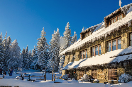 POLAND, GORCE - JANUARY 6, 2015 Mountain shelter on Turbacz in winter scenery, Gorce Poland