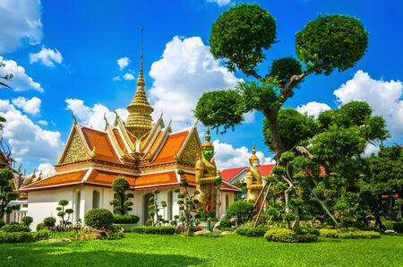 Great Palace Buddhist temple with famous green tree gardens in center of Bangkok, Thailand photo