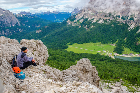 Climber on Sentiero Bonacossa, Cadini di Misurina, Dolomites Mountains, Italy photo