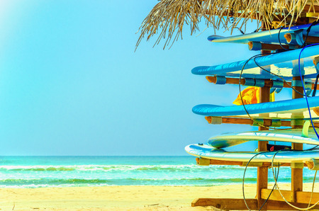 Exotic beach with colorful surfboard and azure water, Sri Lanka, southern Asia Stock Photo