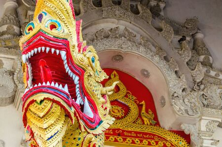 malaysia culture: Dragon on gates of the Buddhist temple in Bangkok, Thailand Stock Photo