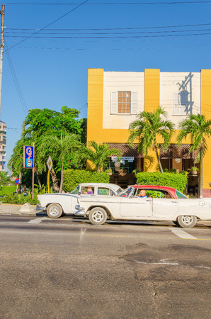 bought: HAVANA, CUBA - DECEMBER 2, 2013: Classic American cars one of streets in Havana, where old cars bought before Cuban revolution are icon view of Cuba