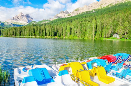 lake misurina: Colored pedalos on the Lake Misurina lago di Santa Caterina and Auronzo di Cadore, Province of Belluno, Veneto, Sexten Dolomites, South Tyrol, Italy